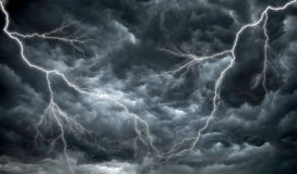 Dark, Ominous Rain Clouds And Lightning Royalty Free Stock Photos