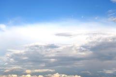 Dark, ominous rain clouds and blue sky. Stock Image