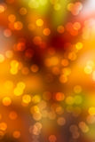 Dark orange bokeh background. Bokeh on blurred dark orange background (sparkle Stock Photo