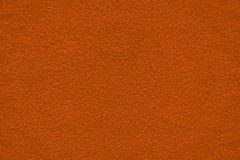 Dark orange bronze felt surface close up. Texture and background Stock Photos