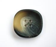 Dark Ornate Plastic Button Isolated on White Stock Photos