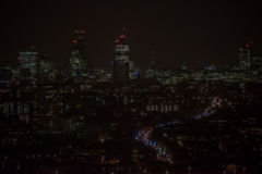 Dark and out of focus city background Stock Images