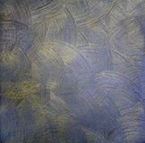 The dark paint texture with round divorces is blue with gold. Decorative coating for walls Stock Photos