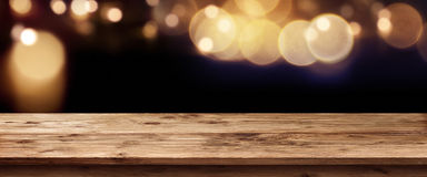 Dark panorama with golden glows. In front of a empty wooden table for a concept Royalty Free Stock Photography