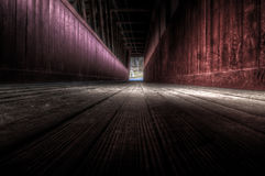 Dark Passage. Dark w/ interesting color and lots of texture, a look inside this narrow wooden passage Royalty Free Stock Image