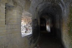 Dark passage inside a ruined castle Stock Image