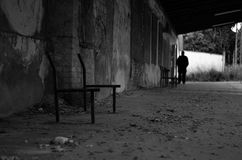 Dark past. Black&white photography of desolated factory guarded by a watchman Royalty Free Stock Photo