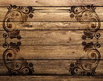 Dark patterns burned into a wooden Board. Royalty Free Stock Images