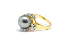 Dark pearl with diamond and gold ring isolated Royalty Free Stock Image