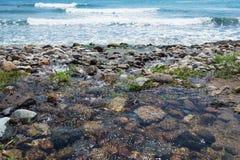 Dark pebble in Santa Caterina di Pittinuri shoreline Stock Images