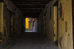 Dark pedestrian path tunnel Stock Photography