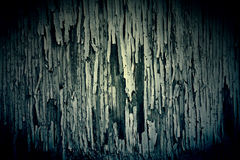Dark Peeling Paint Texture on Old Grungy Wood Royalty Free Stock Images