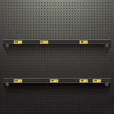 Dark Pegboard Background with shelves and price tags Royalty Free Stock Images
