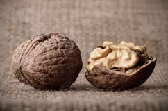 Dark photo of walnuts on sackcloth Stock Photography
