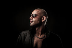 Dark photos of a mysteryous handsome young man with sunglasses Stock Photography
