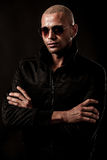 Dark photos of a mysteryous handsome young man with sunglasses Royalty Free Stock Photos