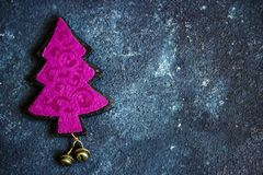 Pink eve with gold bells decorations on dark backdrop stock photography