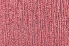 Dark pink fluffy background of soft, fleecy cloth. Texture of textile closeup Royalty Free Stock Photo
