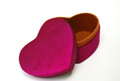 Dark pink heart gift box-Thai silk. This elegant heart shaped gift box is made from Thai silk. Thai silk is produced from the cocoons of thai silkworms.Today Stock Image