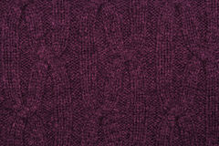 Dark pink knitted texture Royalty Free Stock Photography