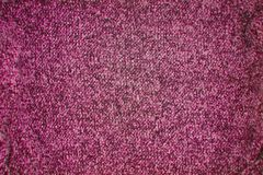 Dark pink knitted texture pattern background stock photo