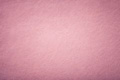 Light pink matt suede fabric closeup. Velvet texture of felt. Dark pink matte background of suede fabric, closeup. Velvet texture of seamless light rose woolen stock photo