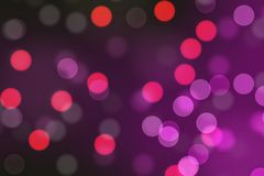 Dark pink and red circular bokeh, abstract background. Royalty Free Stock Photo