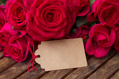 Dark pink  roses with hearts and tag Stock Photo