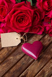 Dark pink  roses with hearts and tag Royalty Free Stock Photo