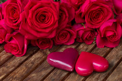 Dark pink  roses with hearts and tag Royalty Free Stock Photos