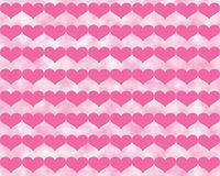 Dark Pink Valentine Hearts on Cloudy Light Pink Background. Dark pink Valentine's Day hearts in a grid over a surreal background of lighter pink clouds Royalty Free Stock Photo