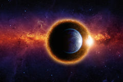Dark planet and planet Earth stock illustration