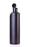 Dark Plastic Bottle Stock Image