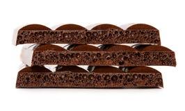 Dark porous chocolate Stock Images