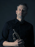 Dark portrait of a brass musician Royalty Free Stock Images