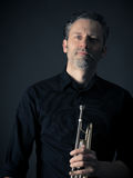 Dark portrait of a brass musician Royalty Free Stock Photography