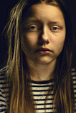 Dark portrait of a depressed teen girl Stock Photography