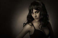 Dark portrait of elegant brunette woman. Royalty Free Stock Photography