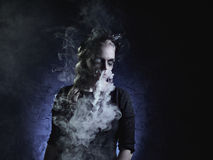 Dark portrait of evil witch in smoke Royalty Free Stock Images