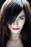 Dark portrait of a girl Stock Photos