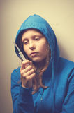 Dark portrait of a junk teen girl with syringe Stock Photos