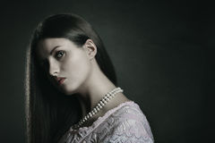 Dark portrait of pale woman Stock Photo