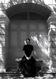 Dark portrait of sad Asian woman in black clothes. At the old building royalty free stock photos