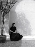 Dark portrait of sad Asian woman in black clothes. At the old building royalty free stock images