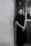 Dark portrait of sad Asian woman in black clothes. At the old building royalty free stock photography