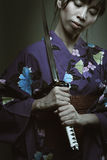 Dark portrait of samurai woman Stock Photo