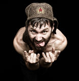 Dark portrait of scary evil sinister bearded man with smirk, makes various hand's signs and expresses different emotions Stock Photo