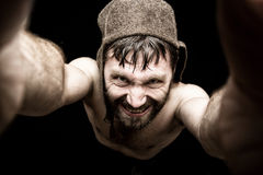 Dark portrait of scary evil sinister bearded man with smirk, makes various hand's signs and expresses different emotions Stock Images