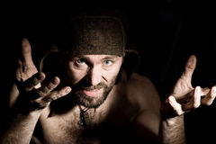 Dark portrait of scary evil sinister bearded man with smirk, makes various hand's signs and expresses different emotions Royalty Free Stock Image