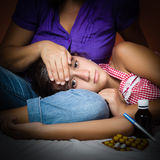 Dark portrait of a sick girl Royalty Free Stock Photography